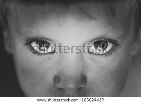 Eyes close-up little boy - stock photo
