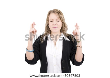 Eyes closed.Young woman crossing her fingers.  shot on white background. - stock photo
