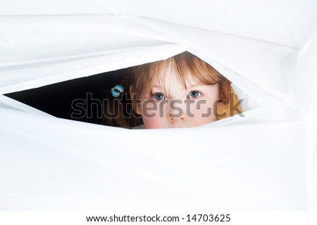 Eyes is a mirror of soul. A young girl look at you. Close-up. Isolated over white background