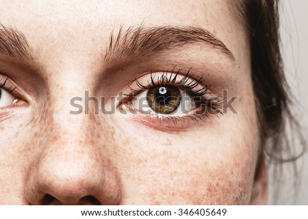 Eyes nose woman Young beautiful freckles woman face portrait with healthy skin - stock photo