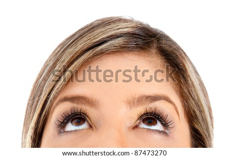 Eyes of a woman looking up - isolated over a white background