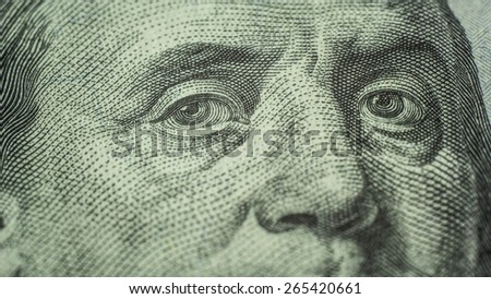 eyes of Benjamin Franklin 100 dollars note close-up - stock photo