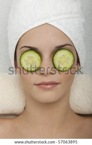 Eyes Treatment with Cucumber - stock photo