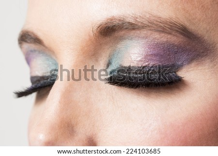 Eyes with makeup on purple and green