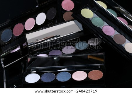 Eyeshadow Collections on Black Background - stock photo
