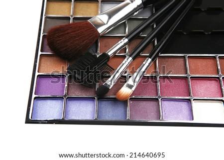 eyeshadow kit for make-up over white background - stock photo