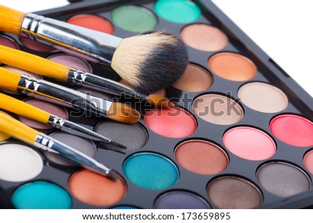 Eyeshadow makeup palette with brushes - stock photo