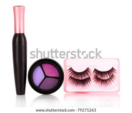 eyeshadows  and mascara and false eyelashes isolated on white - stock photo