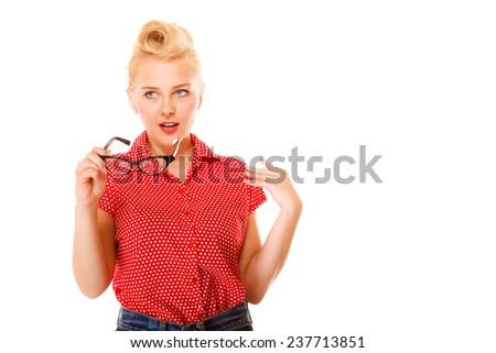 Eyewear. Fashion woman beautiful girl retro hairstyle holding new glasses looking surprised studio shot isolated on white - stock photo