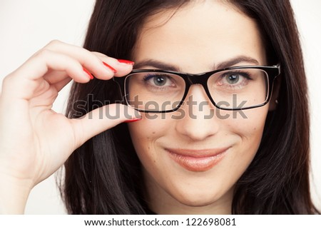 Eyewear glasses woman closeup portrait. Beautiful Brunette Girl holding frame in close-up. Beautiful Young European Girl. - stock photo