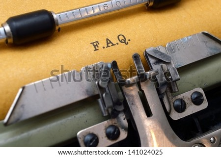 F.A.Q. on typewriter - stock photo
