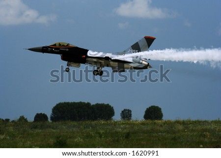 F16 jet fighter prepairing to land during an airshow in Romania