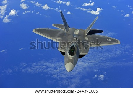 F-22 Raptor fighter flies near Guam. Introduced in 2005 it has speed agility precision stealth technology and a price tag of 150 million. Feb. 16 2010. - stock photo