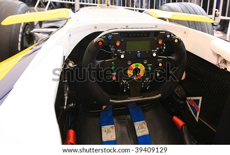 F 1 . Steering of competition car. - stock photo
