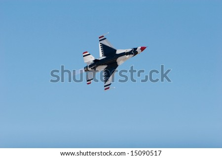 F-16 Thunderbird fighter jet flying during airshow