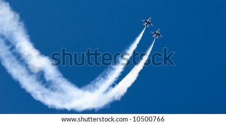 F-16 Thunderbird jets leaving smoke trails - stock photo