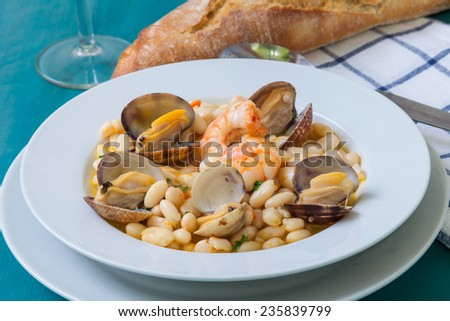 fabes con almejas is a homemade beans and clams seafood from spain culture - stock photo