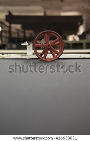 fabric at quality control. with a counting machine measuring the length of a textile piece /roll. production of fine woolen fabrics for suits - in a factory in Sabadell, Spain - stock photo