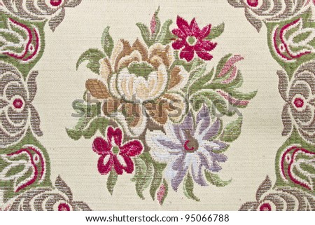 fabric background with the embroidered flowers - stock photo