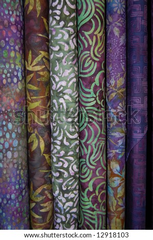 Fabric bolts - Purple batik prints - stock photo