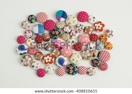 fabric buttons isolated on white background / top view - stock photo