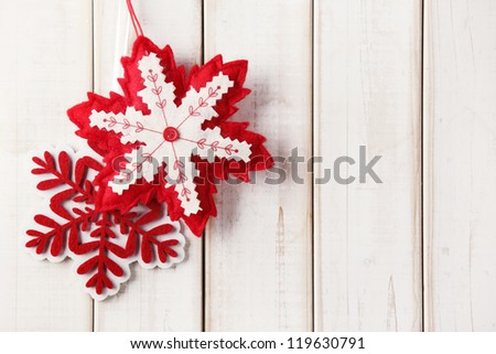 Fabric Christmas ornament hanging on wooden background - stock photo