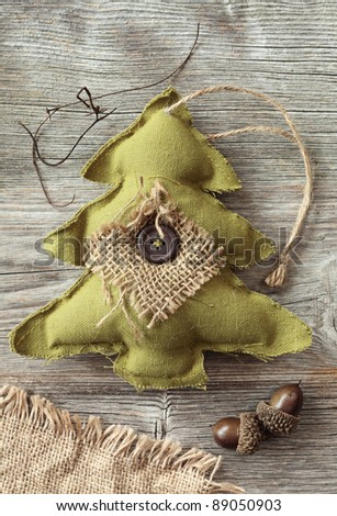 Fabric christmas tree on wooden background - stock photo