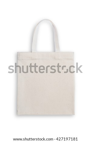 Fabric cloth shopping bag isolated on white background with clipping path: Reusable eco friendly white brown tote made of natural cotton material: Reduce reuse recycle environmental concept campaign   - stock photo