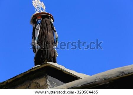 Fabric covered dhvaja or victory banner-ashtamangala-auspicious symbol. Roof of Tashilhunpo-Heap of Glory buddhist monast.-seat of Panchen Lama. Shigatse-Yarlung Tsangpo and Nyang Chu junction-Tibet. - stock photo