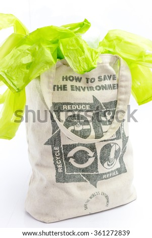 Fabric eco bag with recycle sign icon made of green leaf