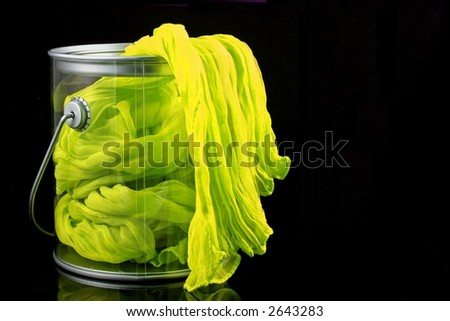 Fabric Flowing over Edge of Paint Can