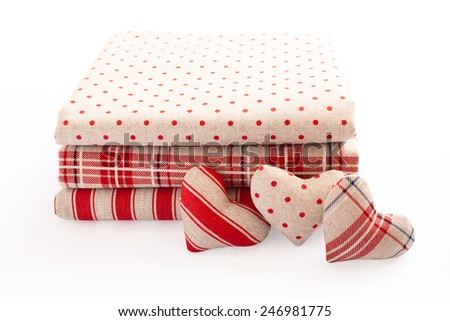Fabric for decoration stacked and accessories for needlework isolated. Heart made of cloth. - stock photo