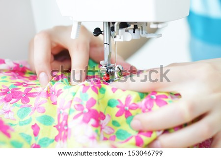 Fabric in a sewing machine - stock photo