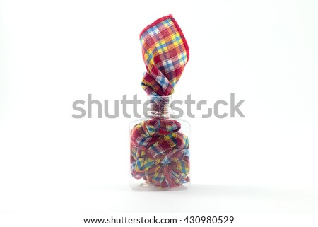 Fabric in empty bottles isolated on white background. Bottles abstrack. - stock photo
