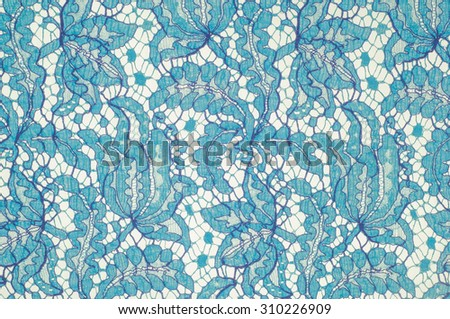 fabric lace. a fine open fabric, typically one of cotton or silk, made by looping, twisting, or knitting thread in patterns and used especially for trimming garments - stock photo