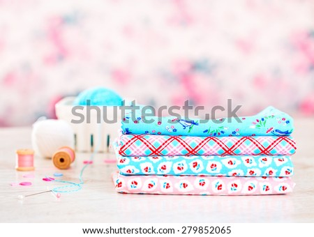 Fabric Pile of colorful folded textile on white table - stock photo