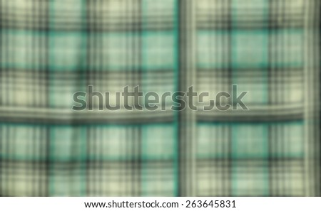 Fabric plaid texture. Cloth background, blur out focus - stock photo
