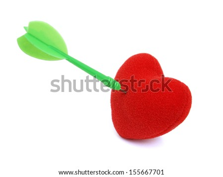 Fabric red heart stabbed by green dart on white background