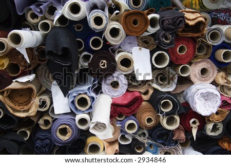Fabric rolls in the street market - stock photo