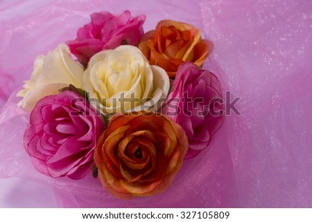 fabric rose on romantic pink fabric for Bridal - stock photo