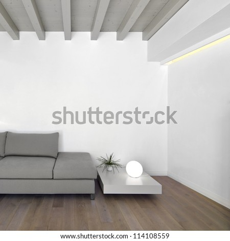 fabric sofa in the modern living room with wood floor - stock photo