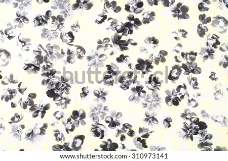 Fabric texture beige color with black flowers. the textured background of cotton fabric of beige color with a pattern from abstract florets - stock photo