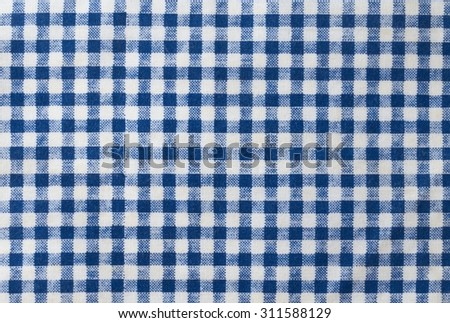 Fabric Texture, Close Up of A Blue and White Checked Towel or Napkin Pattern Background. - stock photo