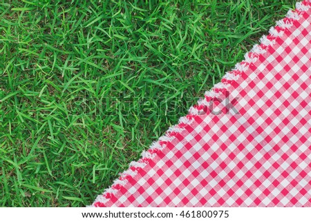 Fabric white and red on green grass background texture. copy space for write text.