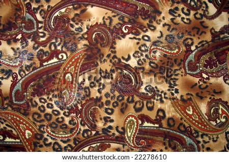 Fabrics from artificial silk  of the brown color with pattern. - stock photo