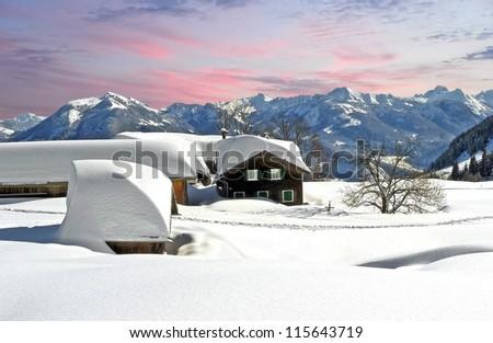 fabulous austrian winter wonderland with a quaint village - stock photo