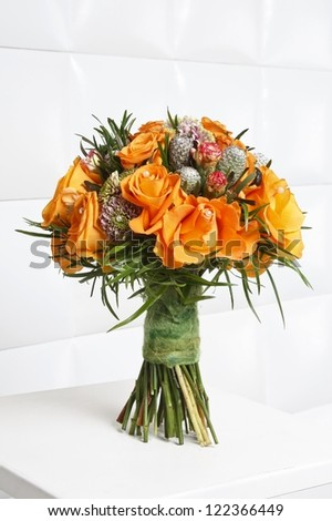 Fabulous bouquet of orange roses and other flowers - stock photo