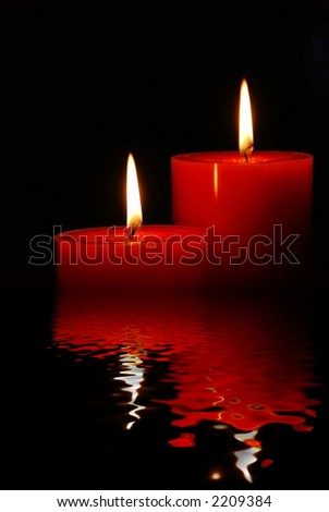 fabulous candles in rendered water - stock photo