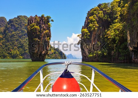 Fabulous holiday in Thailand. Bay in the Andaman Sea and tropical exotic island. A boat trip with a red lantern - stock photo
