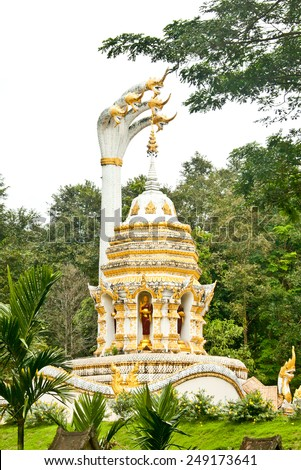 fabulous serpent(naga) and buddhist stupa - stock photo